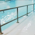 sloped entry into pool. with railing