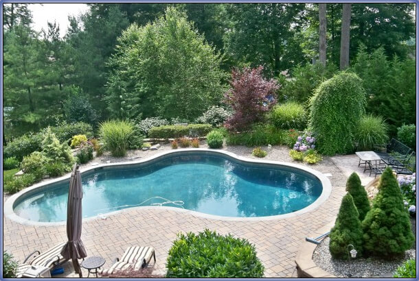 Simple ideas for landscaping with a semi inground pool for Simple inground pool designs