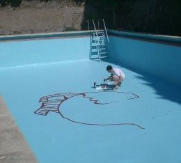 painting underwater murals in a pool