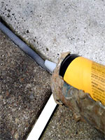 seasteadbuilding.com Vulkem caulked being applied to pool expansion joint