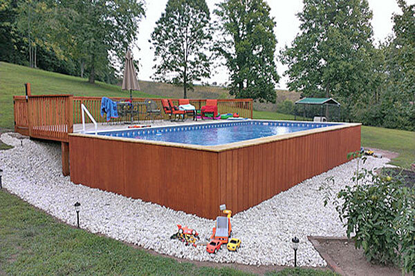 phot showing aboveground pool with outside wood panels
