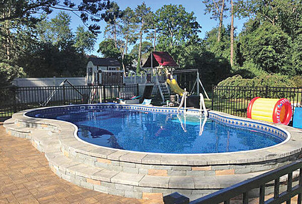 semi inground pool with paver stones